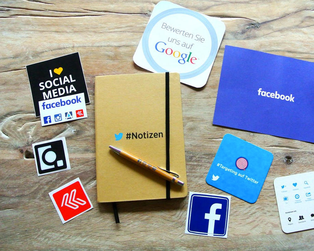 Social Media icons on a variety of papers and notebooks